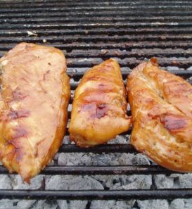 Bourbon Chicken cooking on charcoal grill